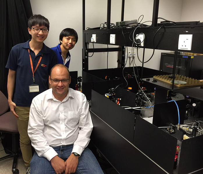Researchers from the Centre for Quantum Technologies and Data Storage Institute with their experiment.