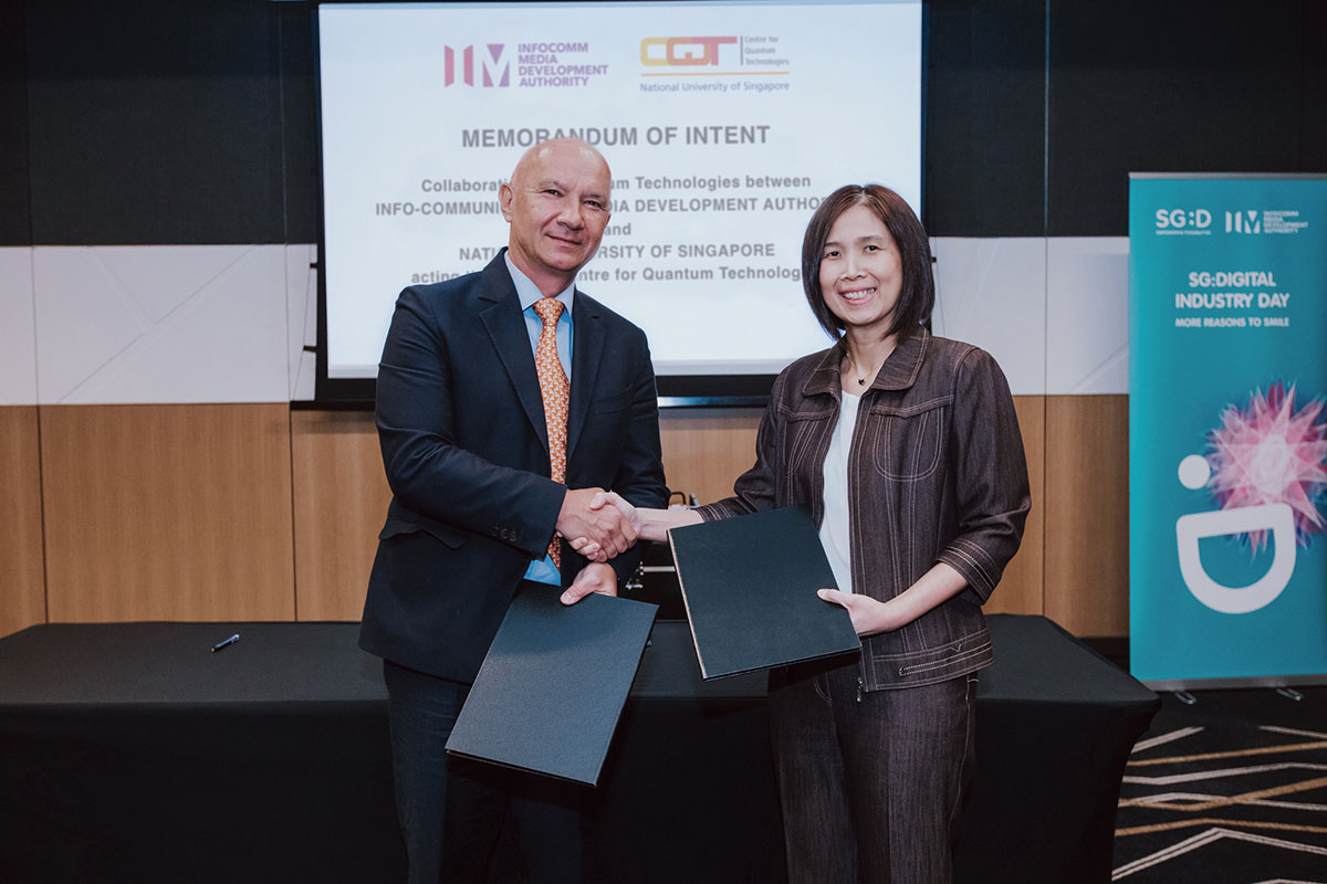 Artur Ekert (left) of CQT and Aileen Chia of IMDA (right) pictured at the signing of a Memorandum of Intent between the organisations..