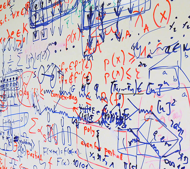 Whiteboard at the Centre for Quantum Technologies in Singapore with many layers of writing