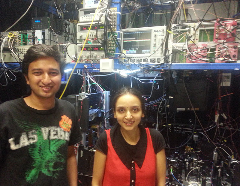 PhD students Bharath Srivathsan and Gurpreet Kaur Gulati with their experiment at the Centre for Quantum Technologies in Singapore