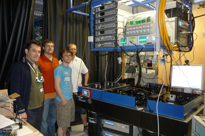 Photograph of CQT researchers with the optical frequency comb installed in 2011.