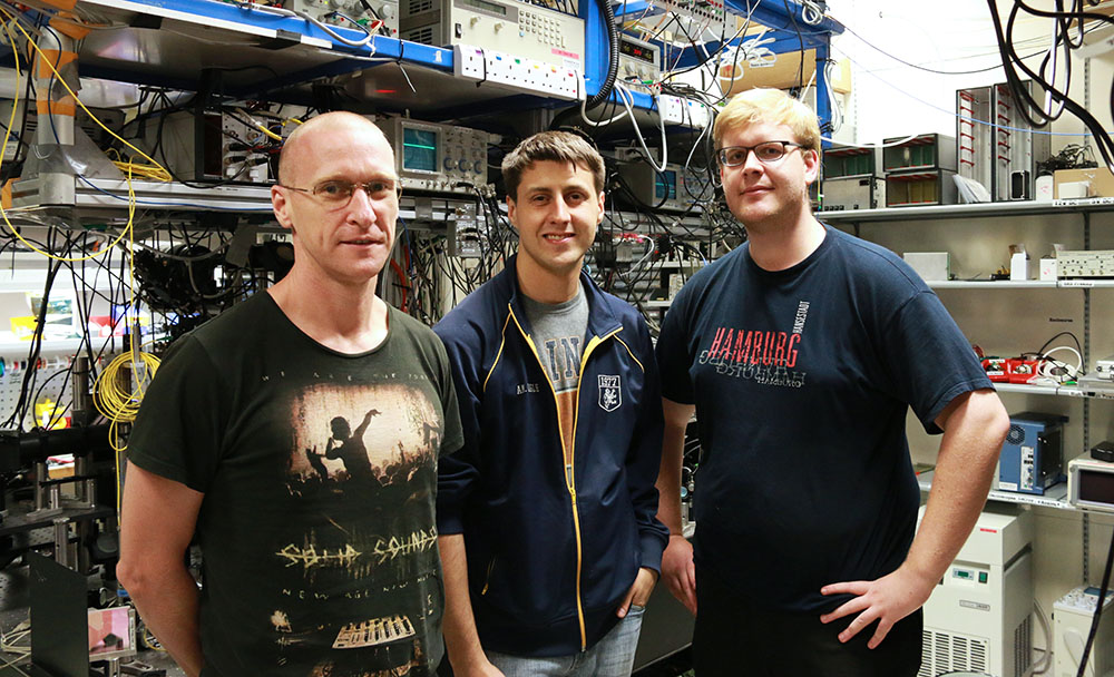 Murray Barrett, Kyle Arnold and Markus Baden in their lab at the Centre for Quantum Technologies, Singapore.